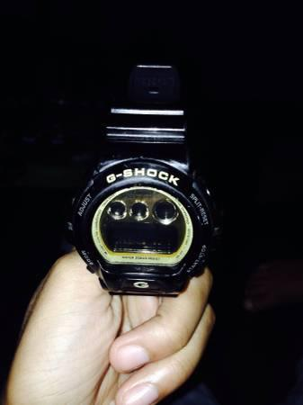 Black and gold g shock - $50