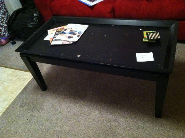"""Black """"Ashley"""" coffee table and 2 matching end tables"""