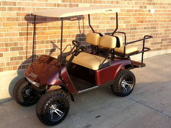 Black Cherry Lifted EZGO Golf Cart, Turn Signals, Flip Seat & MORE on dodge golf carts, honda golf carts, ebay golf carts, electric golf carts, polaris golf carts, used golf carts, accessories golf carts, luxury golf carts, custom golf carts, lifted golf carts, yamaha golf carts, ezgo hunting carts, commercial golf carts, john deere golf carts, golf push carts, utility golf carts, gas golf carts, solar panels for golf carts, hot golf carts, concept golf carts,