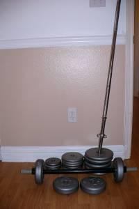 Body building weight set with Bar - $45 (Shreveport,