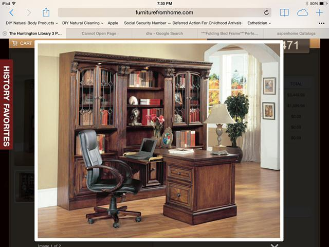 Brand new library cabinete with wine racks and office