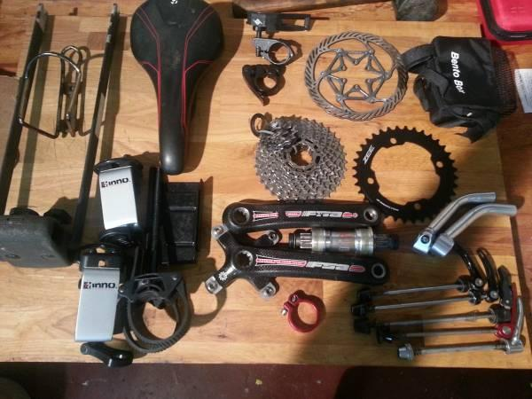 Bunch of bike parts: cranksets, skewers, front shifter