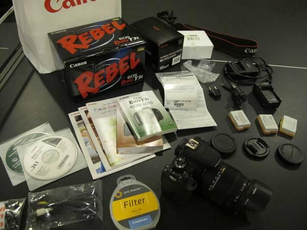 Canon T3i camera body w/ Sigma 18-200 lens and extras -
