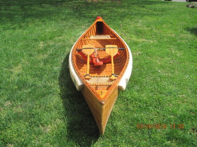 Cedar wood canoe, 12 ft long, 72 lbs with paddles and flotation belt