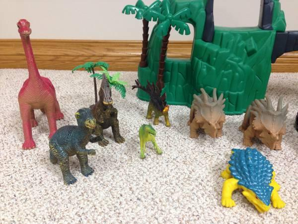 Dinosaur toys and mountain scene - $15