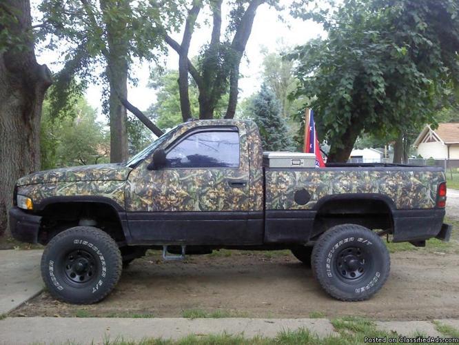 lifted camo dodge trucks