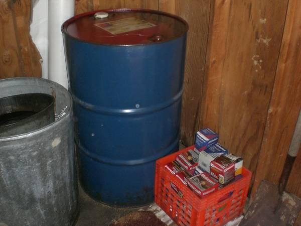 DRAIN OIL - TWO 55 GAL. DRUMS - $100