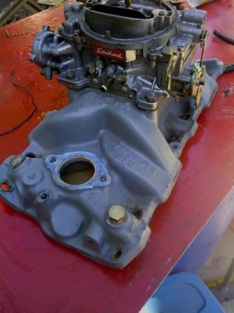 Edelbrock intake and 600 carb sml blk chevy - $200