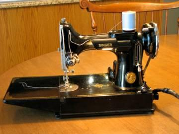 Feather Weight Sewing Machine-Singer - $375