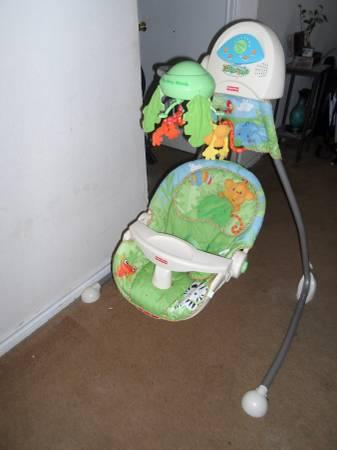 Fisher Price Rainforest Cradle Swing - $50