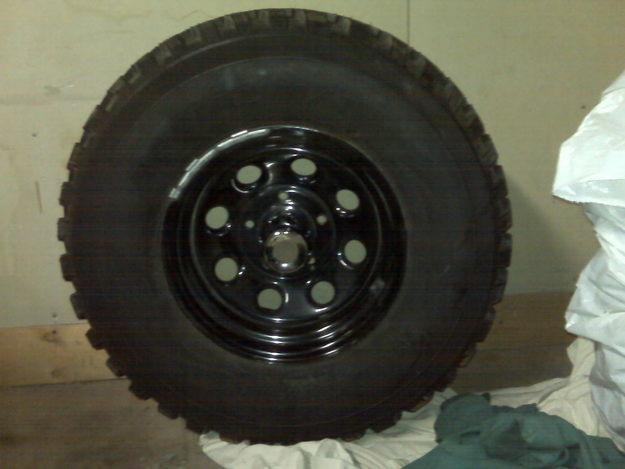 five tires and five rims for truck five lugnuts