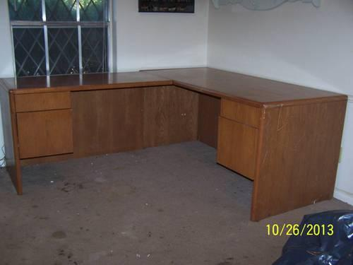 For sale- large four drawer solid wood desk