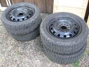 Four winter snow tires on steel wheels - $200 (Gerry)