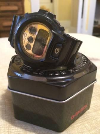 G-Shock Black and Gold - $100
