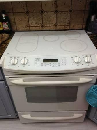 Ge Slide In Glass Top Stove And Maytag Microwave For