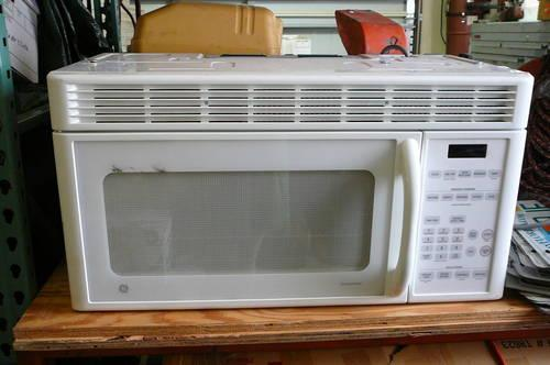 Gently used white GE Spacemaker microwave, above range