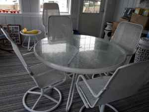 Glass Top Table and 4 Chairs / Lloyd Flanders - $500
