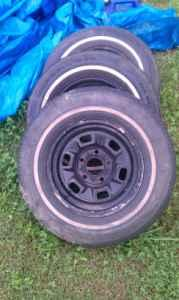 GM wheels with tires $100obo - $100 (Ruffin)