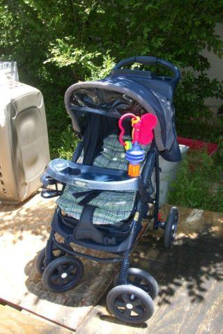 graco stroller with clock storage toy side carrier reduced americanlisted 47439845