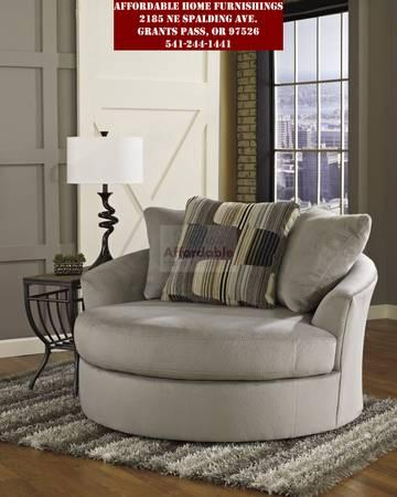 Granite Color Round Swivel Accent Chair   $495