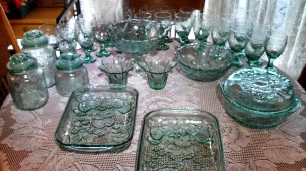 green glassware with fruit pattern