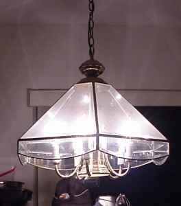 hanging light with 5 +1 lights , glass & brass - $10