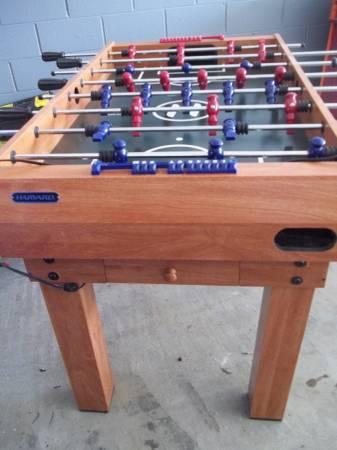 HARVARD FOOSBALL TABLE WITH MULTIPLE GAMES   $200