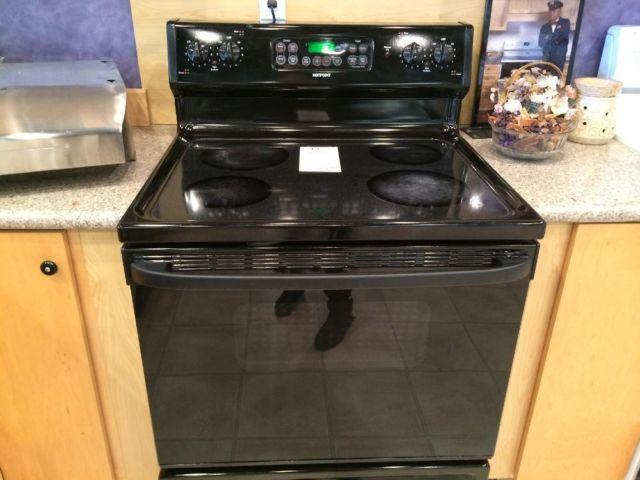 Pictures of black flat top stove appliances — pic 7