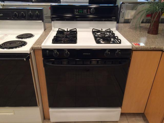 Hotpoint black white gas range stove oven used for for Lakewood wood stove for sale