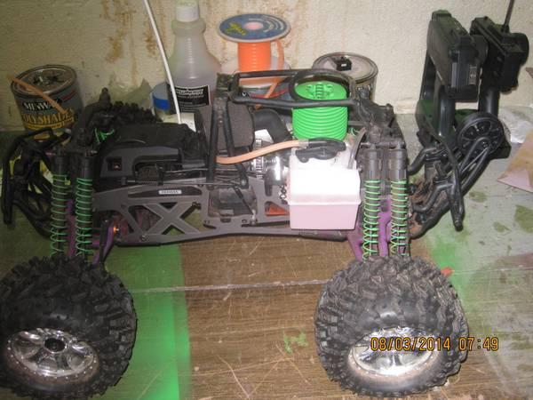 hpi savage x big block nitro 4x4 truck and lots of parts for sale also