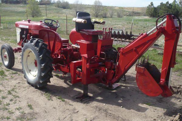 International 240 Tractor : International tractor and backhoe parker for sale