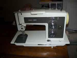 KENMORE SEWING MACHINE WITH CABINET - $35 (RURAL