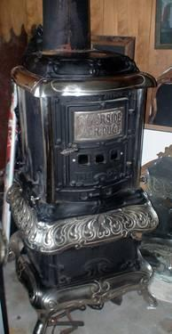Large Cast iron Parlor stove No.28 1911 nickel plated trim for Sale in