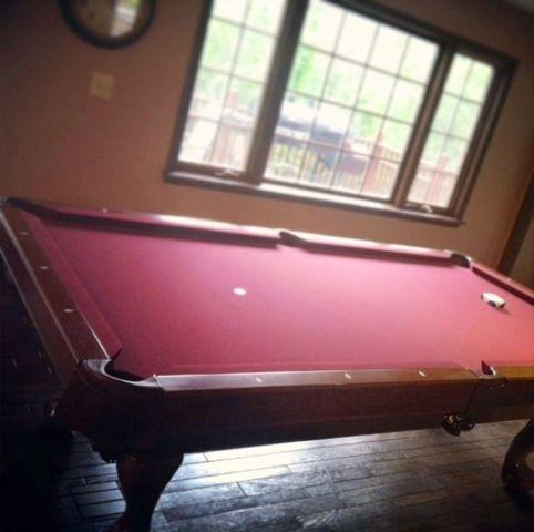 Like new Slate Brunswick pool table and accessories - $1000
