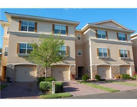 Luxury townhome in prestigious gated community near gulf for Luxury townhomes for sale