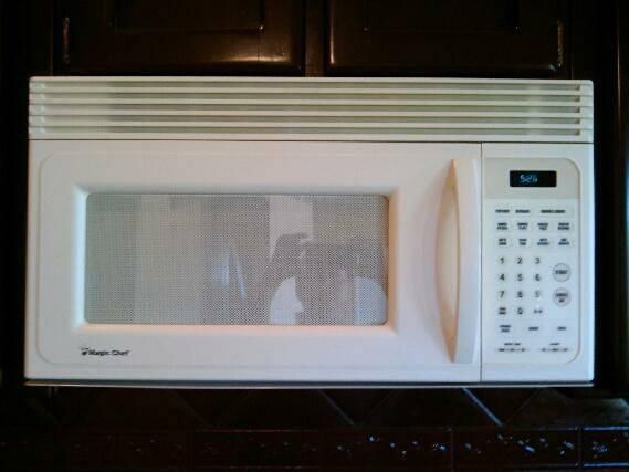 Magic Chef Microwave, over the stove, excellent condition and clean - $85