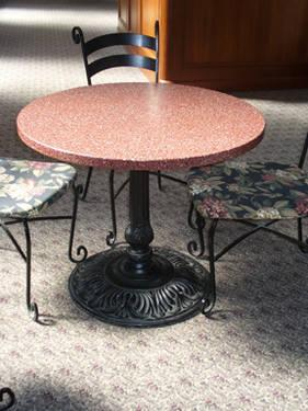 Marble Topped Cast Iron Base Tables With Cushioned Wrought Iron Chairs