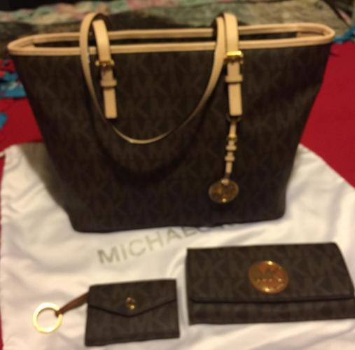 Mkors brown purse , wallet , coin