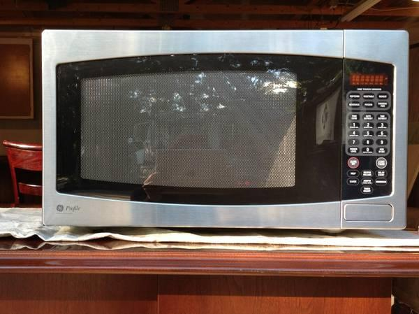 MUST GO MICROWAVE  GE Profile Stainless Steel Microwave - $100