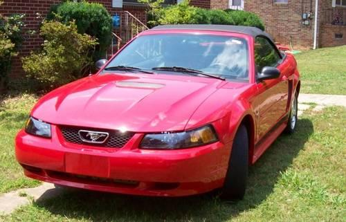 Mustang convertible , 2002, Bright Red, Black top ,
