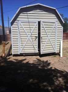 NEW BARN STYLE SHED WITH BUILT IN SHELVES - $3500