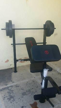 NEW WEIGHT BENCH WITH 80LBS OF WEIGHTS