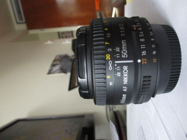 Nikon 50mm f/1.8, Nikon EN-EL3e Battery, LowePro Sling