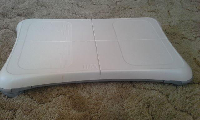 Nintendo Wii fit plus with balance board and motion sensor