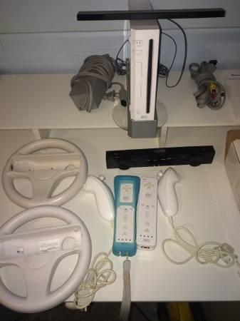 NINTENDO WII , GAMES, CONTROLLERS,WII FIT BOARD - $80