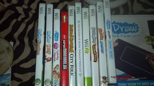 Nintendo Wii with 3 controllers, balance board, U-draw, and games