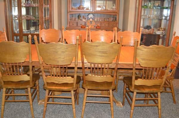 Oak dining room table and 10 chairs - $500