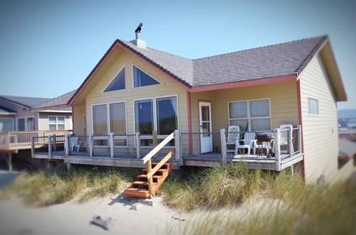 ocean front home on a sandy beach for sale in waldport