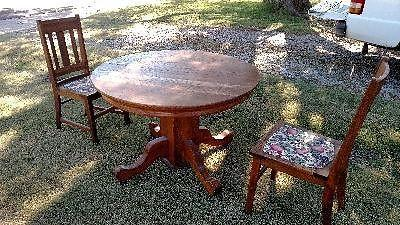 Old Round Oak Table. Two Leaves and Two Old Oak Chairs.