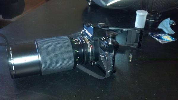 Olympus camera with Vivitar lens - $110